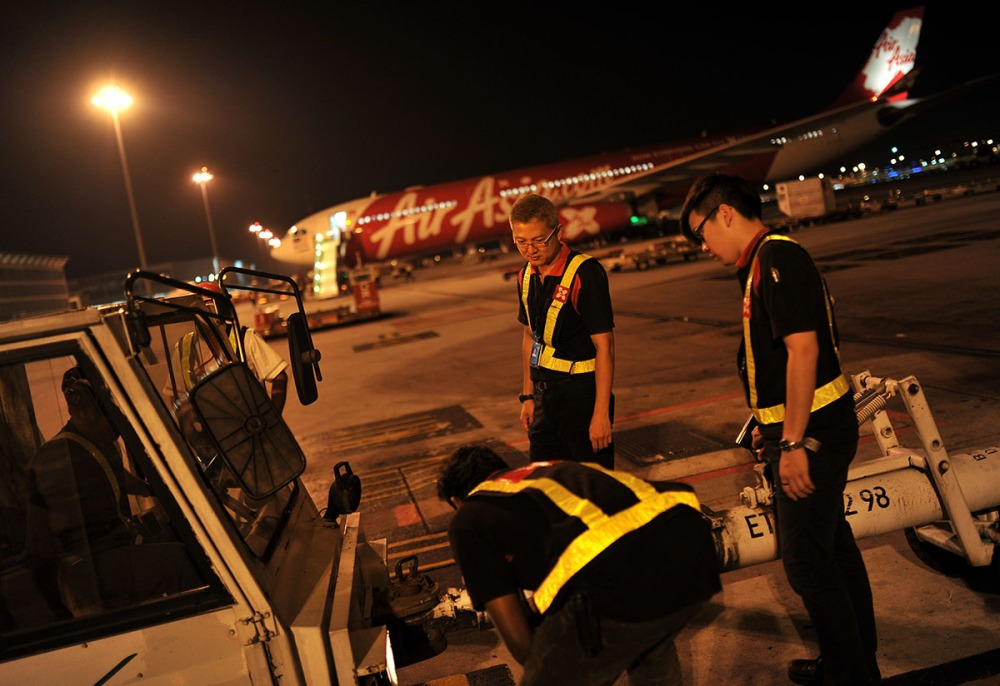 KUALA LUMPUR , 8/5/2014.The Air Asia Staff makes last checking up before a flight departure at Low Cost Carrier Terminal (LCCT) Sepang. On this night LCCT will be last operation and Air Asia will beginning their operation in KLIA2 start on Friday. AWANI / SHAHIR OMAR